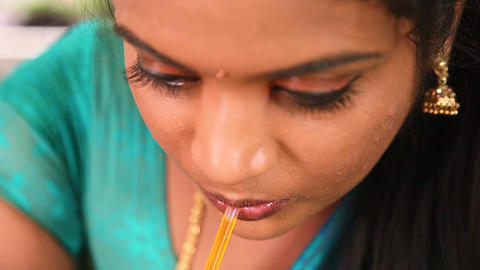woman drinking drink juice through a straw closeup shot face Footage