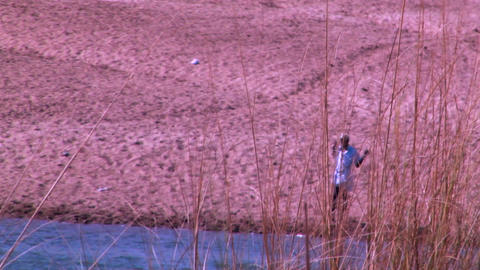 Lonely senior man standing on riverside of the India Footage