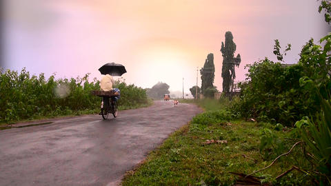 Indian rural road, passing on bicycle, Tuk-tuk auto rickshaw taxi coming towards Footage