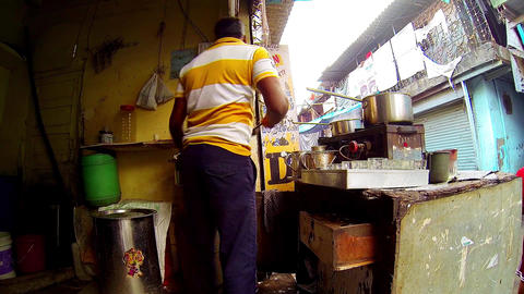 Man making chai in tea shop, Indian Tea Shop Stock Video Footage