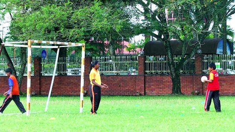 Children playing soccer in a sports ground. Brother and sister playing soccer Live Action