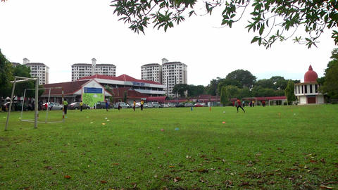 Children playing in a sports ground Footage
