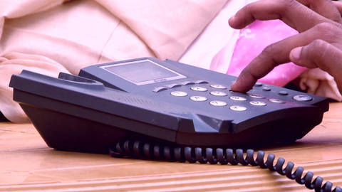 Woman's hands using a telephone, dialing Footage