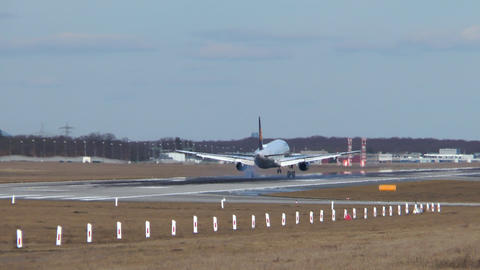 Landing airplane on runway Live Action