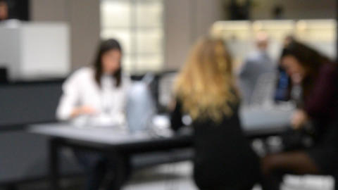 Blurred Background businesswoman sitting at the table and discussing business Footage