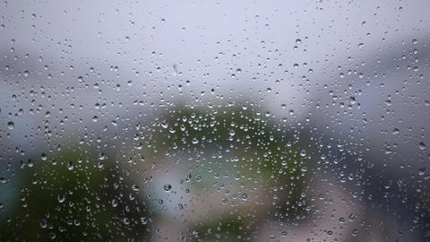 Steamy window with raindrops Footage
