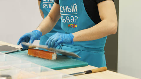 Worker Makes Sushi at Entertainment Center Opening Footage
