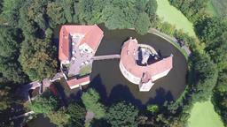 Aerial view of the medieval castle Vischering in Luedinghausen, Germany Footage