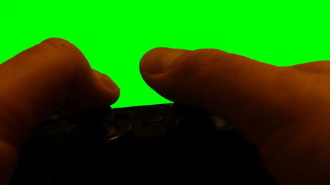 Playing with Console Video Game Controller and Display Greenscren Live Action
