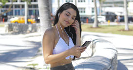 Confident trendy brunette listening to music outside Footage