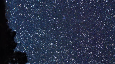 Vertical video. The stars revolve around the polar star. There are disappearing Live Action
