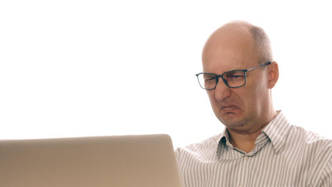 Businessman in glasses working at laptop saw disgusting image. Man made an Footage