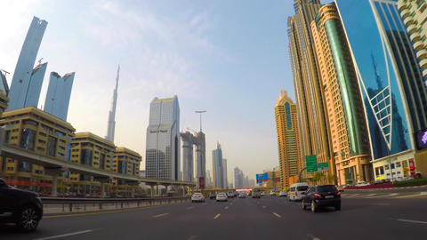 driving through the streets of Dubai, a panorama of the city from the car Footage