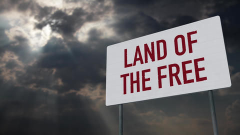 4K Land Of The Free Sign under Clouds Timelapse Animation