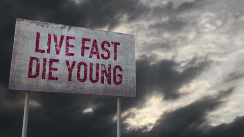 4K Live Fast Die Young Rusty Sign under Clouds Timelapse Animation