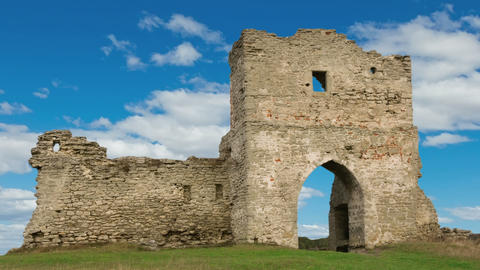 Ruined gates of cossack castle with blue sky and clouds Footage