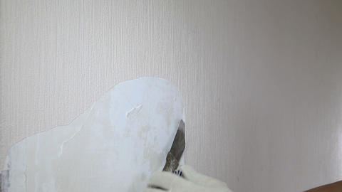 Man removing old wallpaper with the tool Stock Video Footage