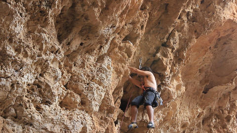 Rock climbing Mountain Climbing Extreme Sports rope cliff... Stock Video Footage