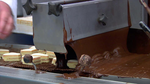 confectioner Baumkuchen triangles chocolate conveyor belt... Stock Video Footage