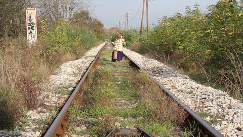 little girl walking on railroad Footage