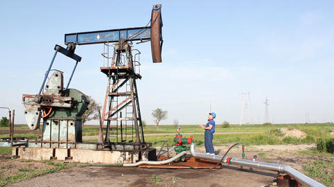 oil worker check pump jack Footage