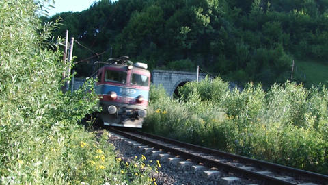 Electric Locomotive Coming Out Of A Tunnel Built Under A Mountain High 8 stock footage