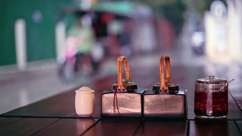 Table sauces and rainy street view from outdoor restaurant, Phnom Penh, Cambodia Footage