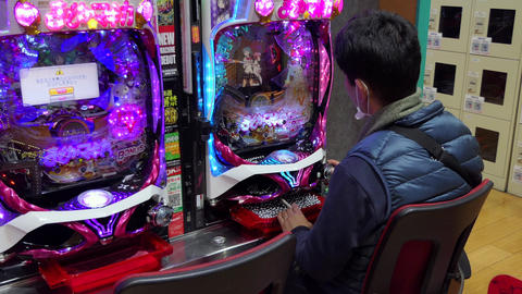 Asian Man Playing Pachinko Lottery Game In Tokyo Japan Asia Live Action
