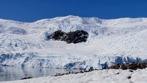 Beautiful snow-capped mountains against the blue sky in Antarctica Footage