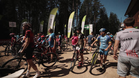 Crowded place near cycling race starting line outdoors in nature Live Action