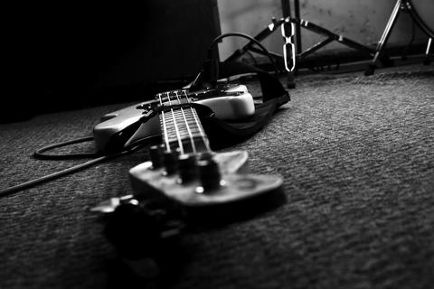 Bass Guitar In Music Studio. Musical Instruments and Equipment フォト