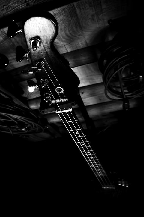 Bass Guitar In Music Studio. Musical Instruments and Equipment Photo