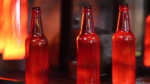 Production of glass bottles for beer. Glass plant Footage