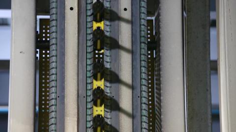 Wine bottles moving along a conveyor belt Footage