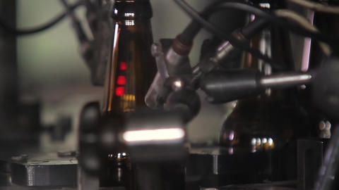 Electronics checks the quality of the bottle Footage