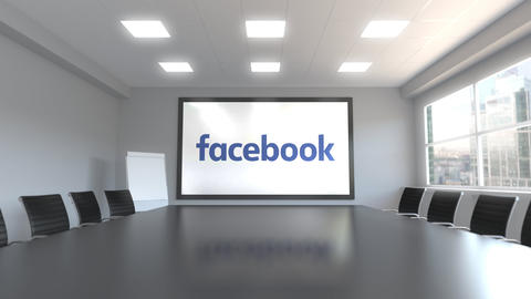 Facebook logo on the screen in a meeting room. Editorial 3D animation Live Action