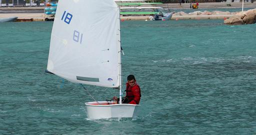 Young Sailor on Optimist Yacht Dinghy Archivo