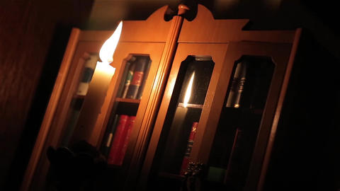 Man night extinguishes the wick of an old candle Footage