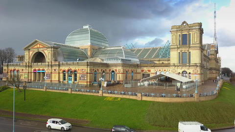 4K aerial view of Alexandra Palace with dramatic sky and clouds behind Archivo