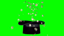 Magic trick with hat and coins on green screen Image
