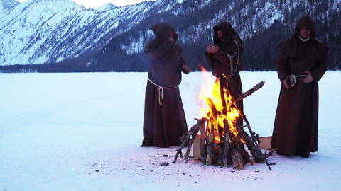 monks are warming near fire in winter 영상물
