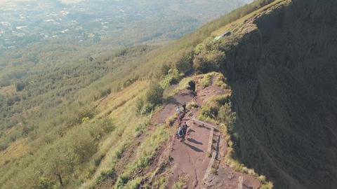 Aerial: Group of Hikers Walking on Path Peak at Batur Volcano. 4K. Bali Archivo