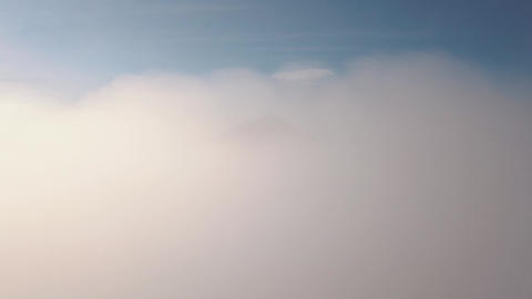 4K Aerial: Mount Agung Volcano view thru Clouds. 4K. Bali, Indonesia Live Action