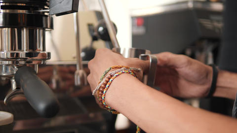 Barista Heating Soy Milk with Professional Coffee Machine for Cappuccino in Footage