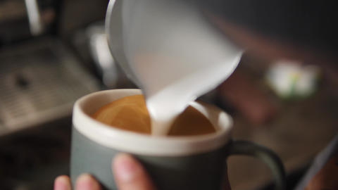 Barista Drawing Latte Art on Coffee with Soy Milk. Process of Making Vegan Footage