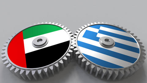 Flags of the UAE and Greece on meshing gears. International cooperation Footage