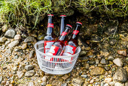 Glen Etive / Scotland - May 28 2018 : Four bottles of Beer cooling in the river Fotografía