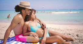 Couple resting on beach Footage