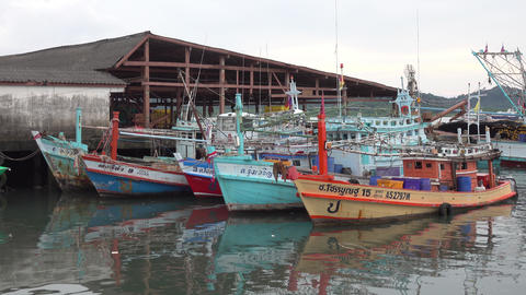 Fishing boats are parked at the pier in Thailand Footage