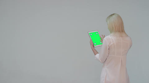 Doctor pressing the green screen of a tablet computer Footage